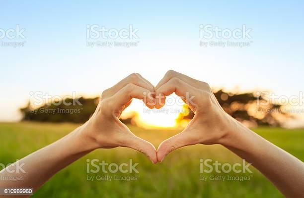 Hand shaped heart against sunset picture id610969960?b=1&k=6&m=610969960&s=612x612&h=f tsbsqqxnoqxswr7utmy5zmppa6kwom1c9moxf8fqa=
