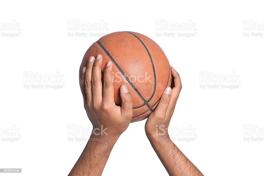 Hand shooting basketball isolated on white background stock photo