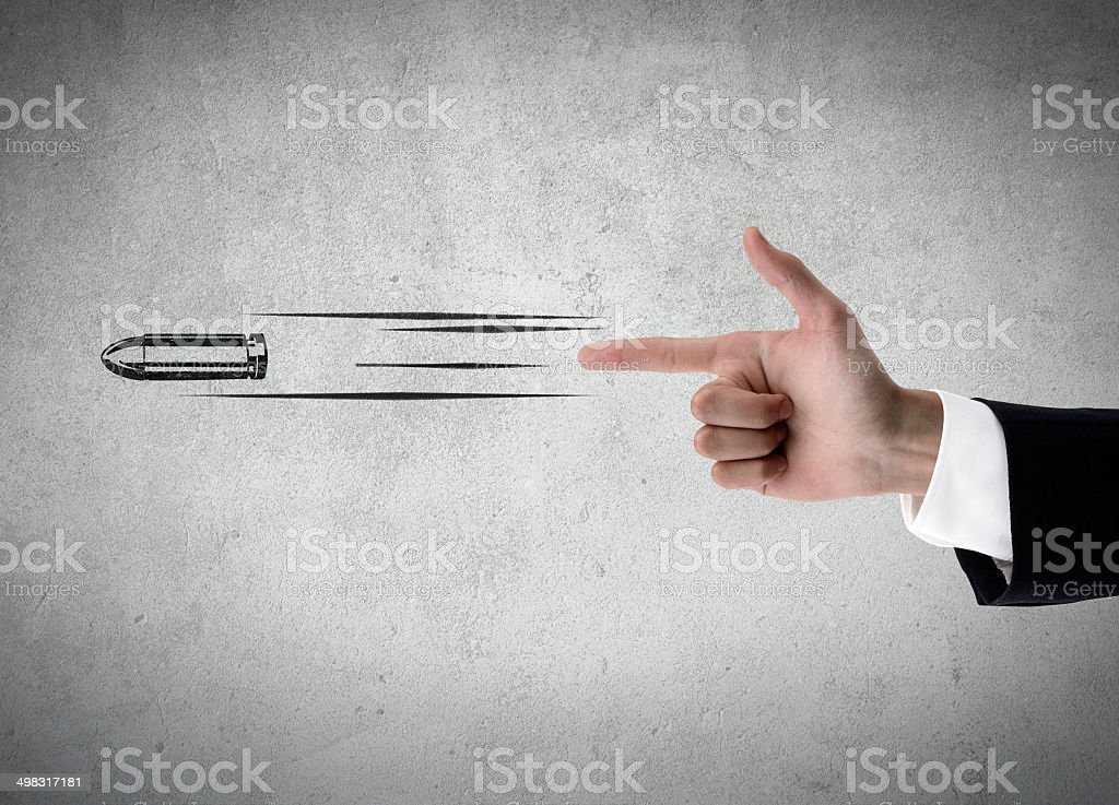 Hand shooting gesture stock photo