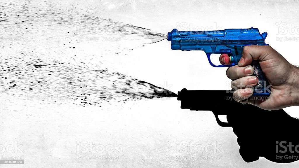 Hand shooting water pistol stock photo