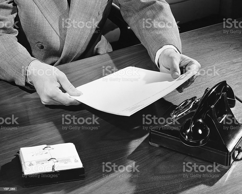 Hand shot of man holding document royalty-free stock photo