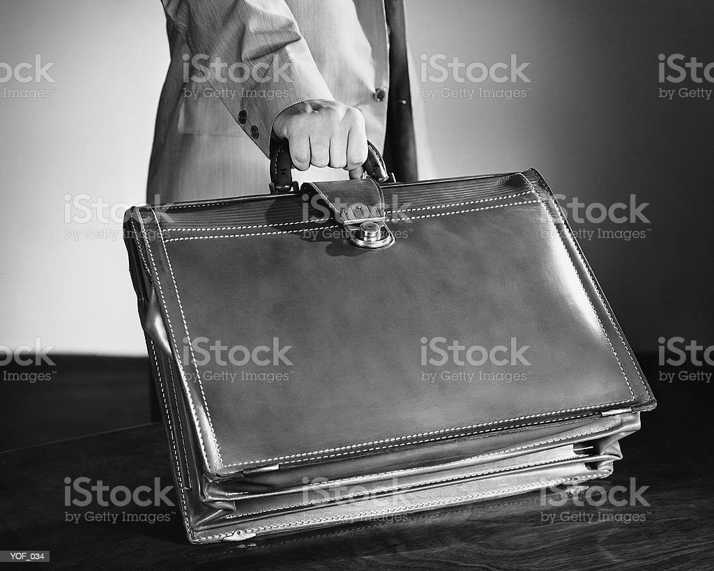 Hand shot of man picking up briefcase 免版稅 stock photo