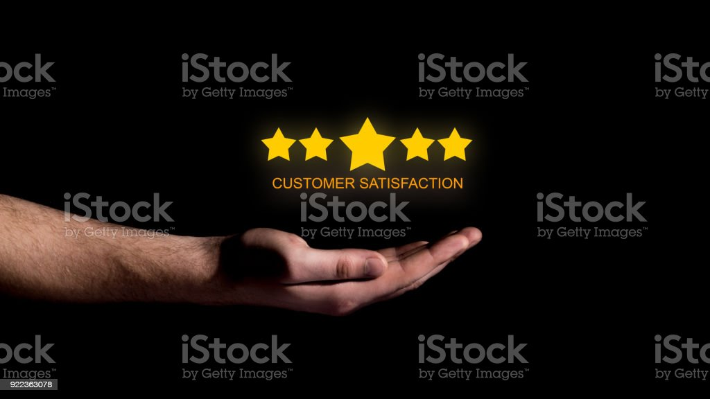 Hand show five star concept of customer satisfaction on black background stock photo