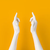 Hand show size gesture. Small and bigger concept. White measuring female hand sculpture isolated on yellow background. 3d rendering.