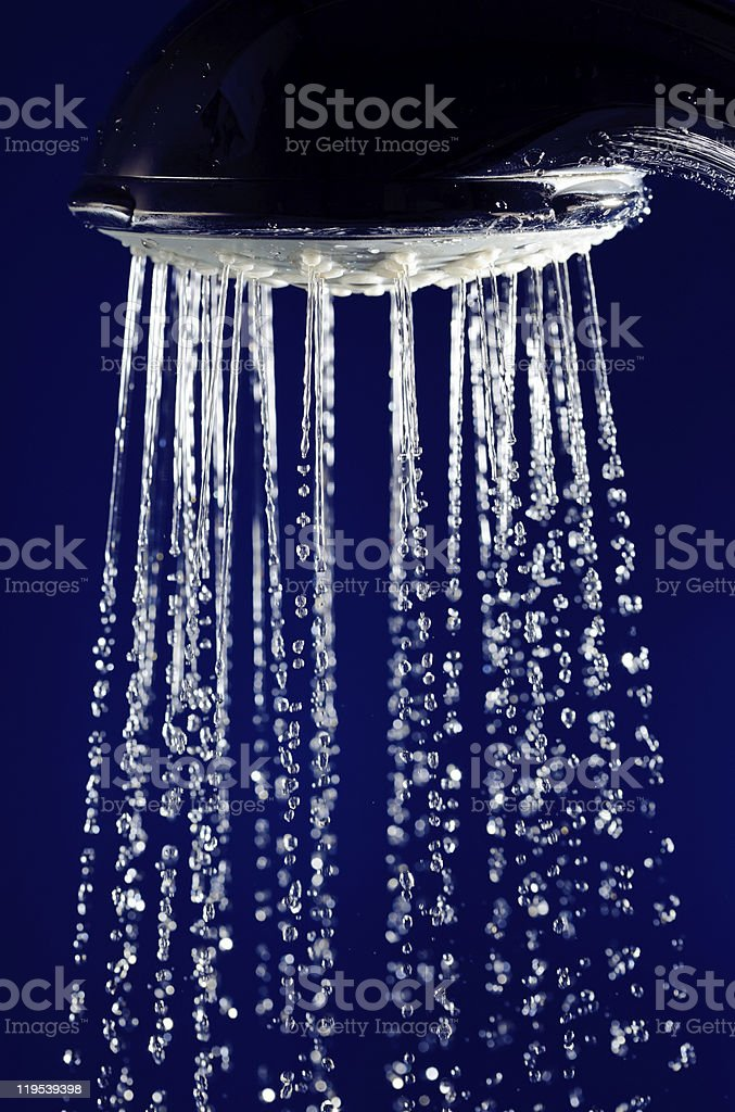 Hand shower douche with stopped motion water drops royalty-free stock photo