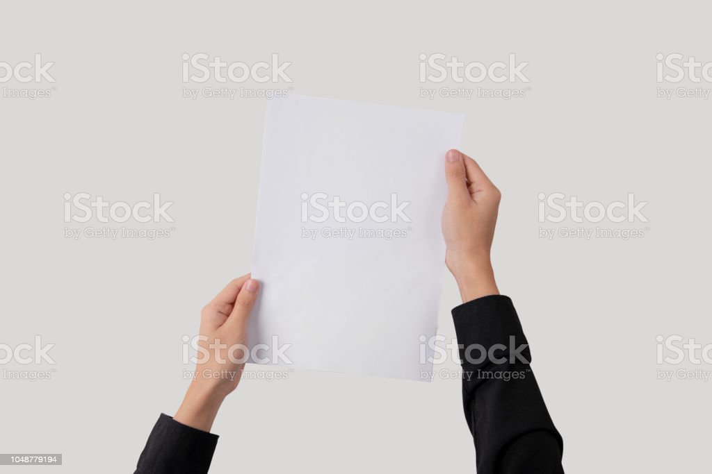 hand showing blank paper A4 flyer for mockup template logo branding on grey background. stock photo