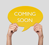 istock Hand showing coming soon on speech bubble 514577180