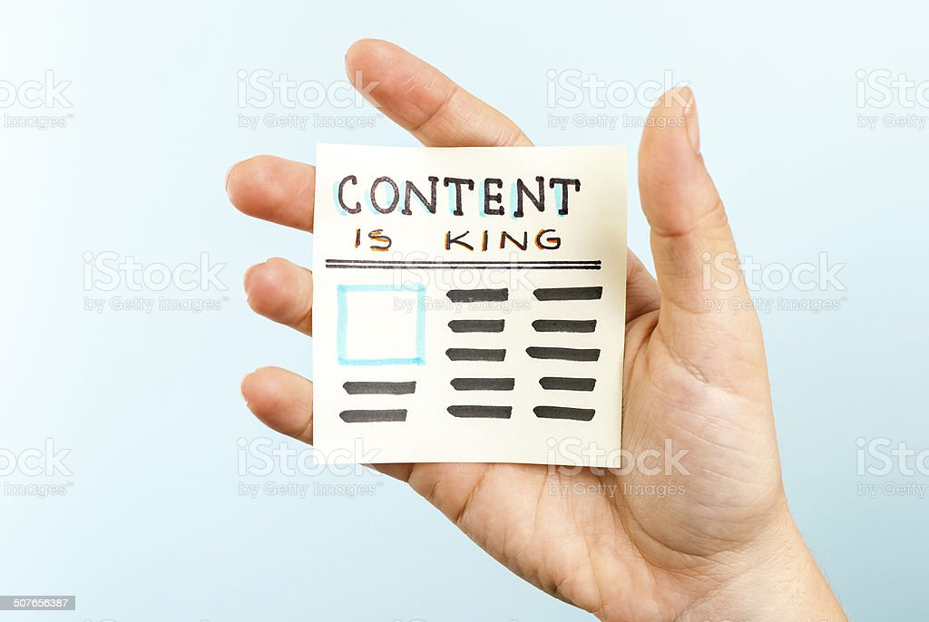 Hand showing content is king message on blue background stock photo