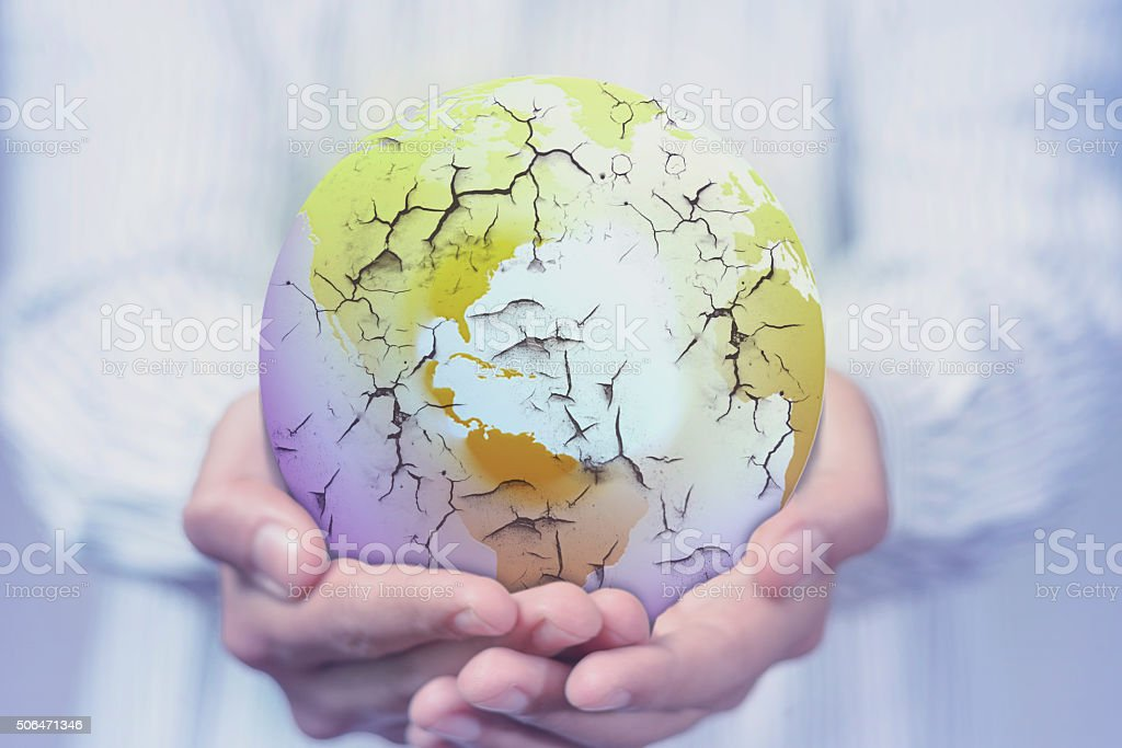 Hand showing damaged earth stock photo