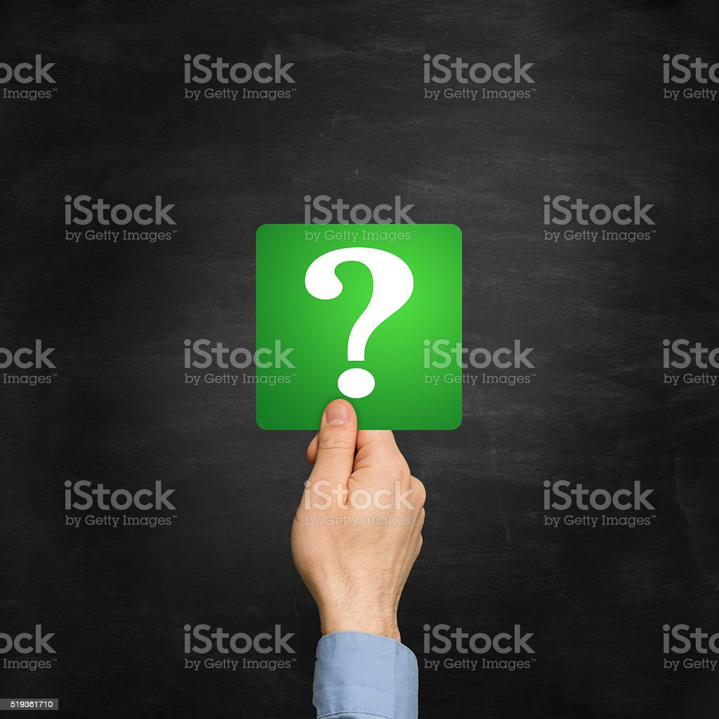 Hand showing green card with question mark stock photo