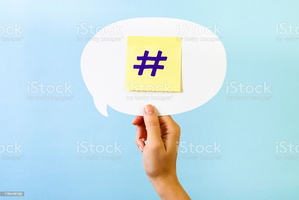 Hand showing hashtag numeral pound sharp internet social media symbol stock photo