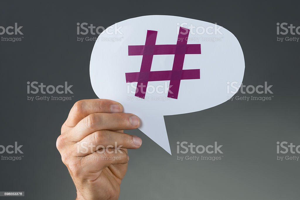 Hand Showing Hashtag On Speech Bubble stock photo