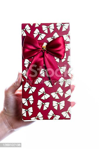 Hand showing holding giving or receiving gift present box isolated on white background.