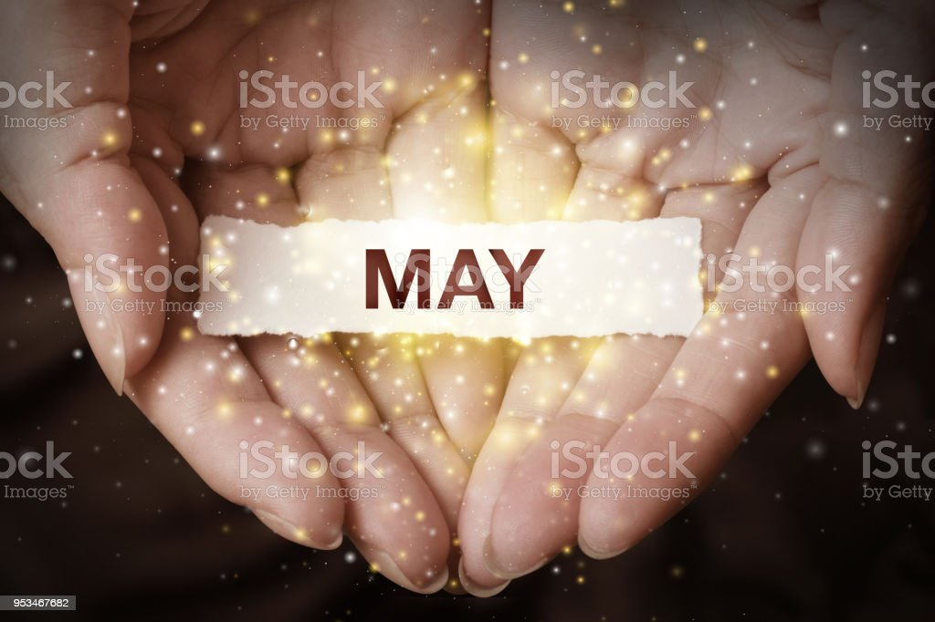 Hand showing May. stock photo