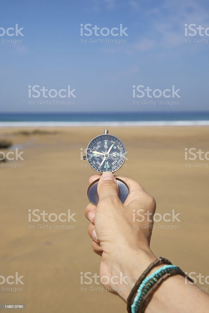 hand showing silver compass royalty-free stock photo