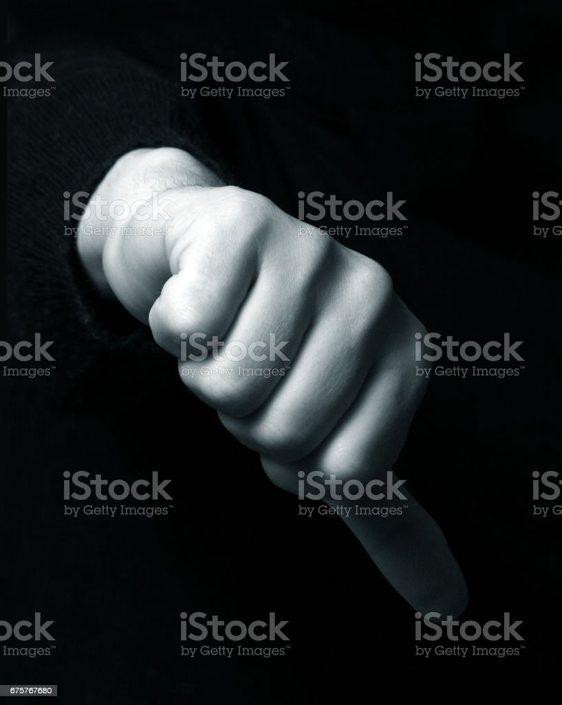 Hand showing the hand down symbol stock photo
