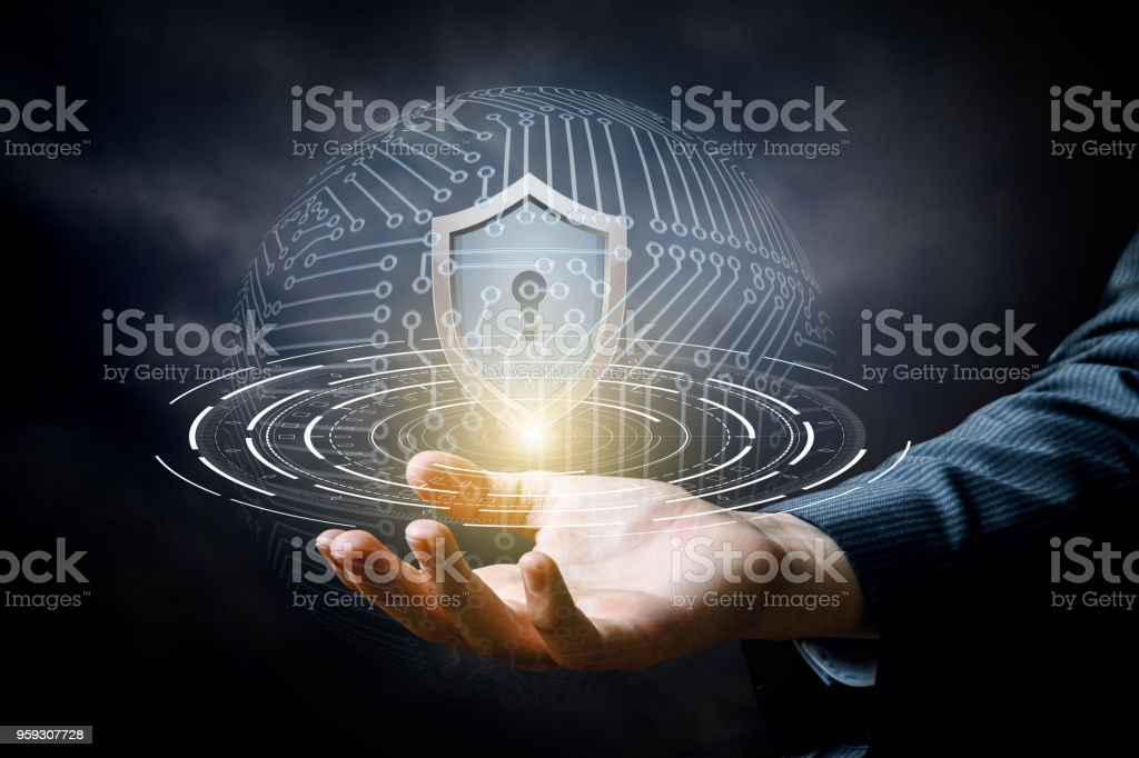 Hand showing the shield for protecting systems. stock photo