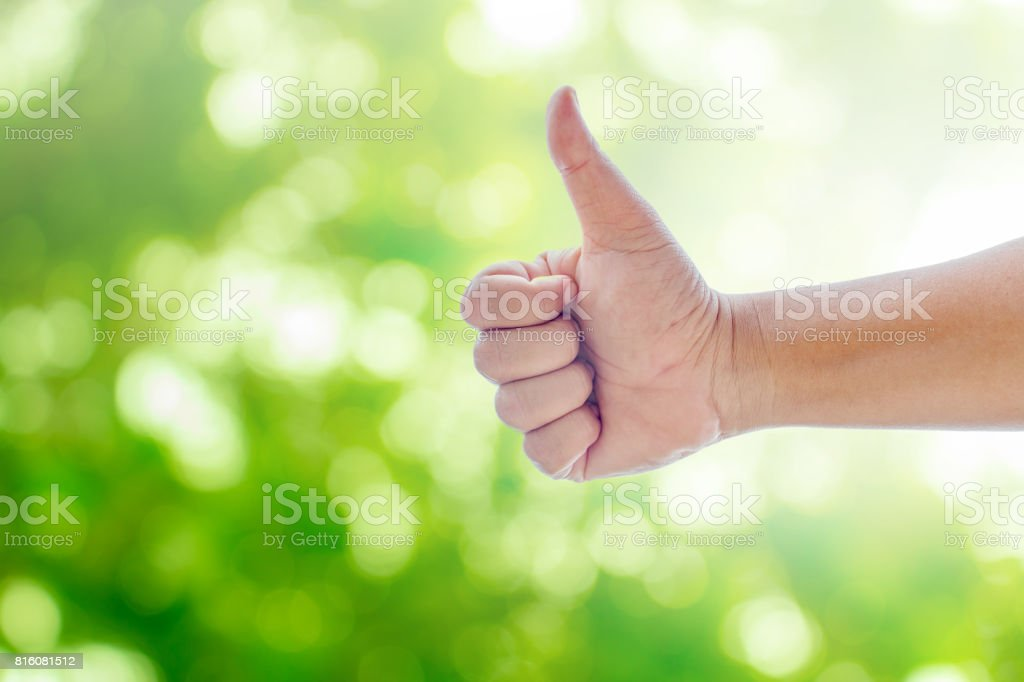 Hand showing thumbs great sign. stock photo