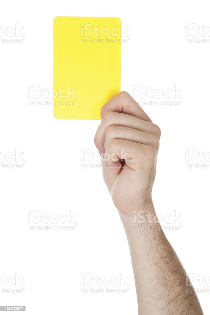 Hand Showing Yellow Card stock photo