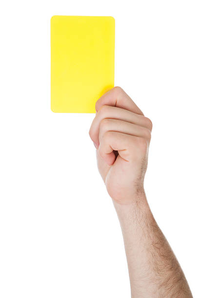 hand showing yellow card - judge sports official stock photos and pictures