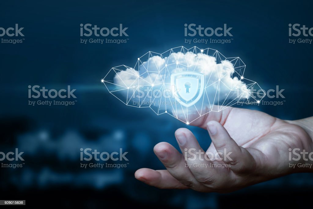 Hand shows a data cloud with a protective shield. stock photo