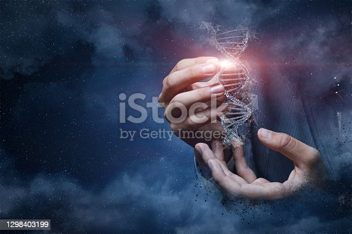 Hand shows a DNA molecule on the background of outer space.