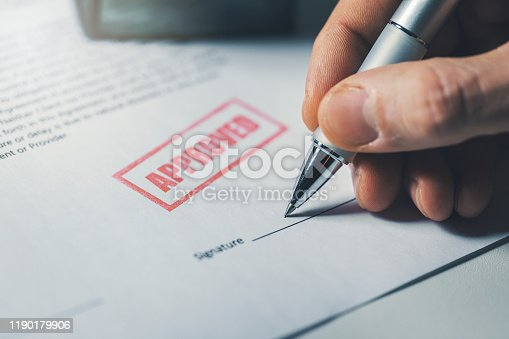 hand sign approved business contract closeup