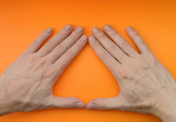 Hand sign triangle. stock photo