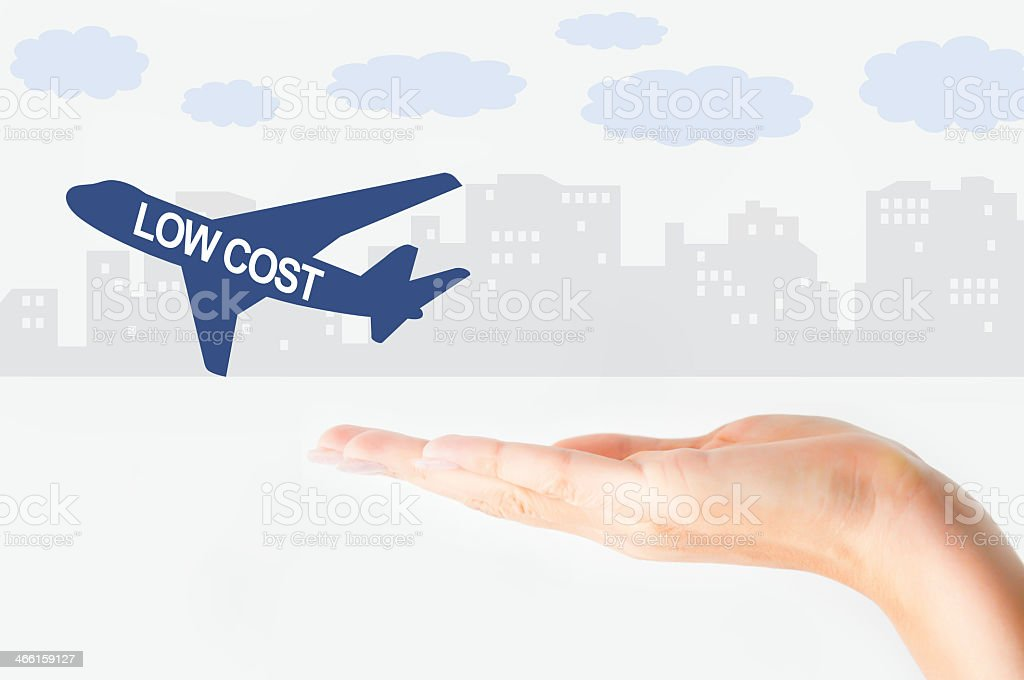 Hand signaling a low cost flight stock photo