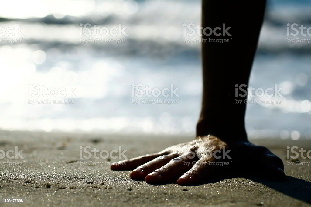 Hand silhouette on the sand royalty-free stock photo