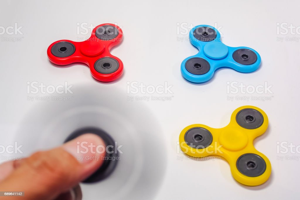 Hand Spinner, Fidget Spinner toy On a white background stock photo