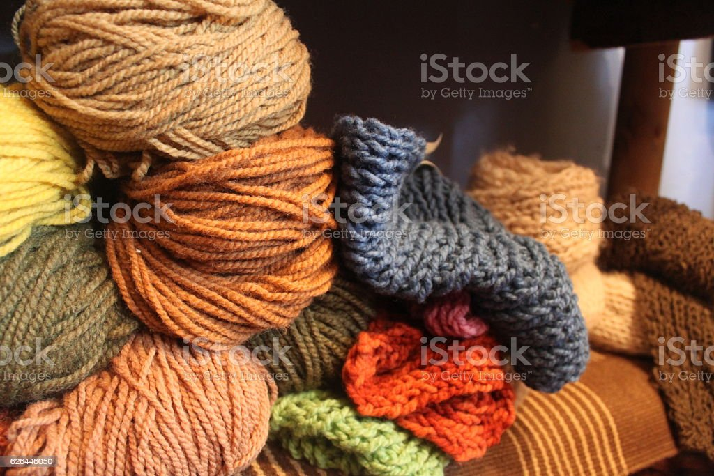 Hand spun and naturally dyed yarn on a shelf. stock photo