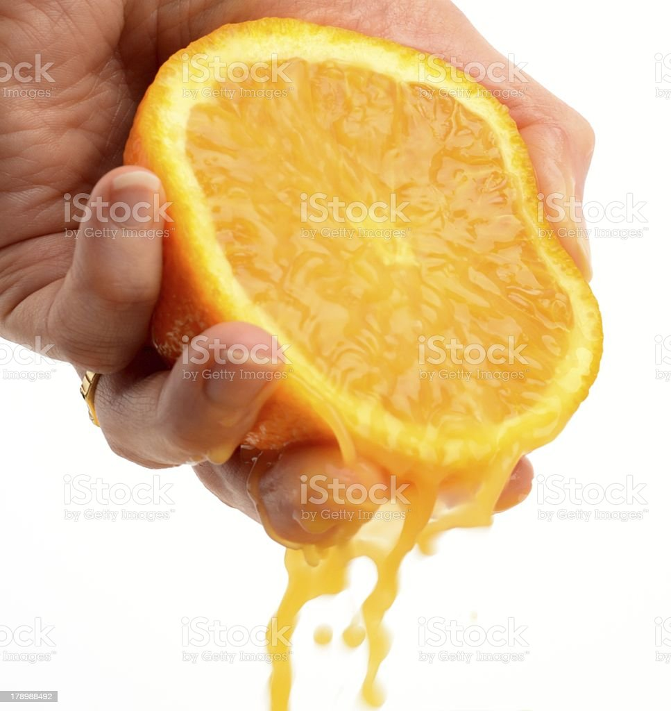 Hand squeezing an orange royalty-free stock photo