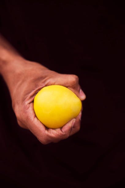 Hand Squeezing Stress Ball stock photo