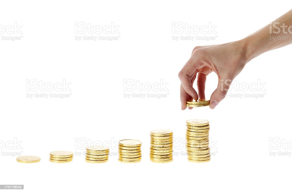 Hand stacking gold coins royalty-free stock photo
