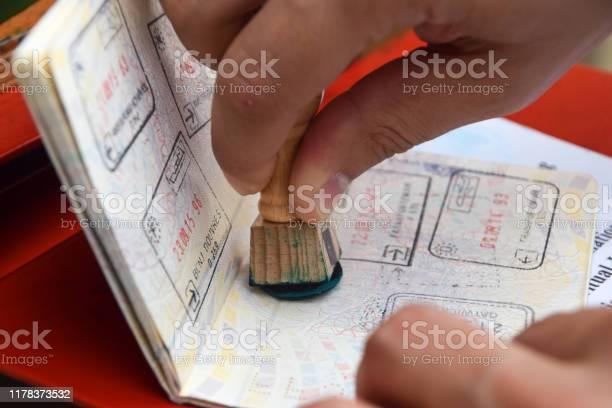 Hand stamping a passport picture id1178373532?b=1&k=6&m=1178373532&s=612x612&h=jhia8r v16hqqpqwu04rwm8jyhm6nsjign xkxrny s=