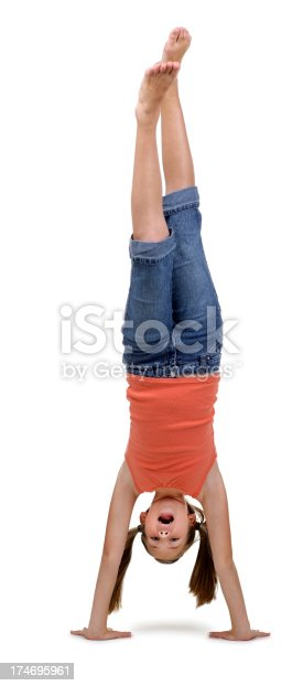 A young girl doing a handstand on a white background.To see more of my Schoolgirl images click the link below: