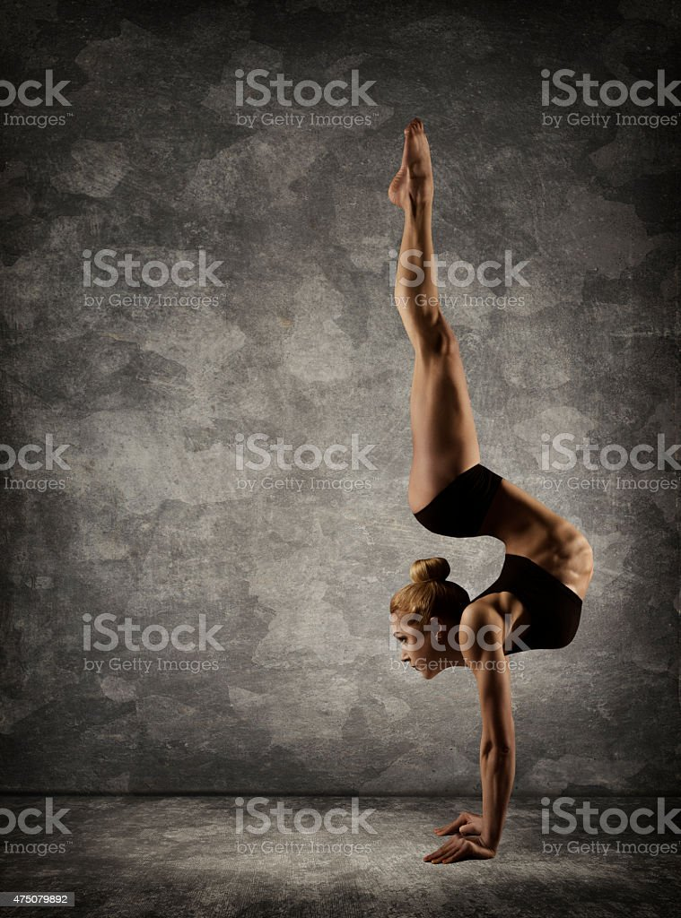 Hand Stand, Woman Handstand, Girl Acrobat Performer doing Hands Standing stock photo