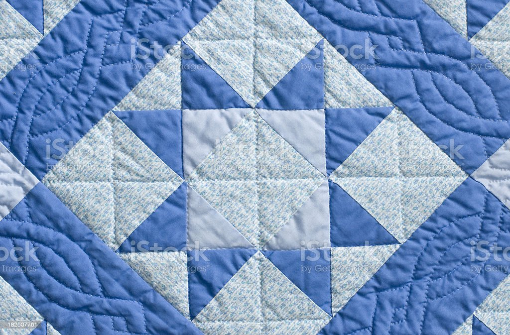 Hand stitched patchwork quilt stock photo