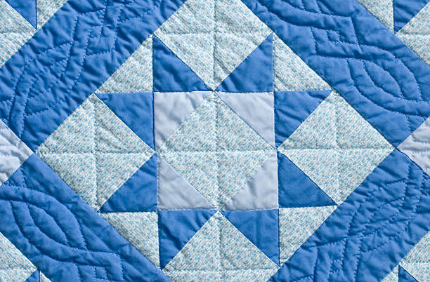 hand stitched patchwork quilt - quilt stock photos and pictures