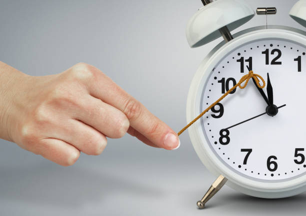 Hand stop clock, time management concept Hand stop clock, time management concept bending over backwards stock pictures, royalty-free photos & images