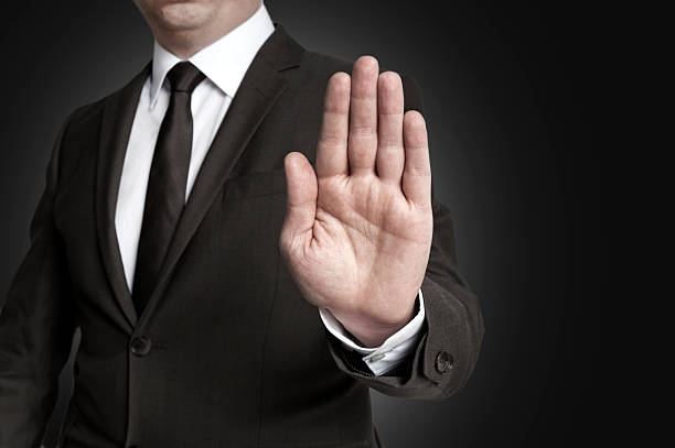 Hand stop shown by businessman Hand stop shown by businessman. stop single word stock pictures, royalty-free photos & images