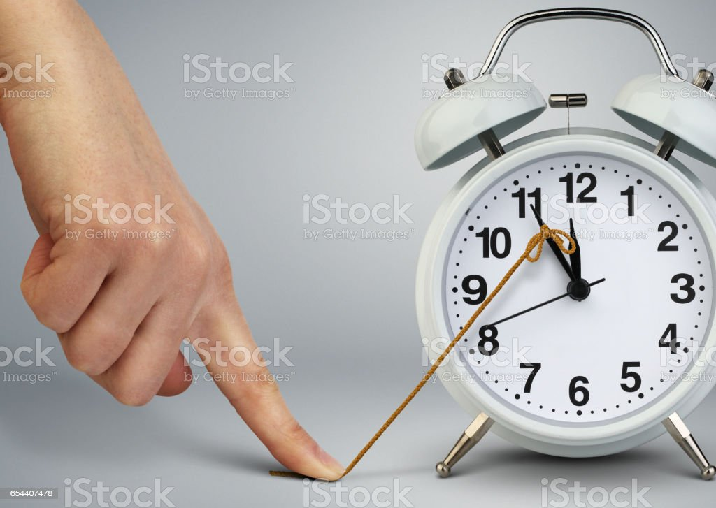Hand stop time on clock, deadline concept stock photo