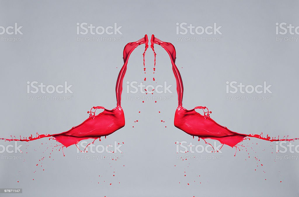 Hand stopping red paint in mid-air royalty-free stock photo