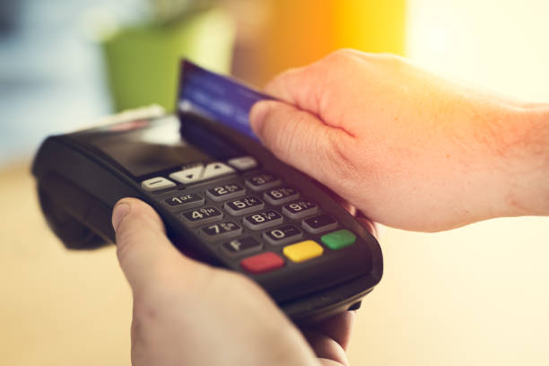 Hand Swiping Credit Card on POS terminal in Store Hand Swiping Credit Card on POS terminal in Store smart card stock pictures, royalty-free photos & images