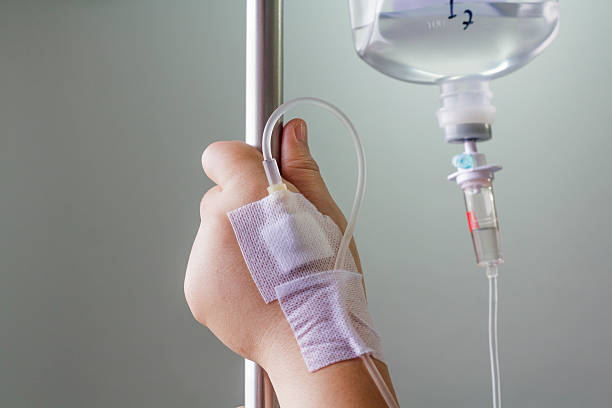 hand swollen by saline intravenous (iv). hand swollen by saline intravenous (iv). saline drip stock pictures, royalty-free photos & images