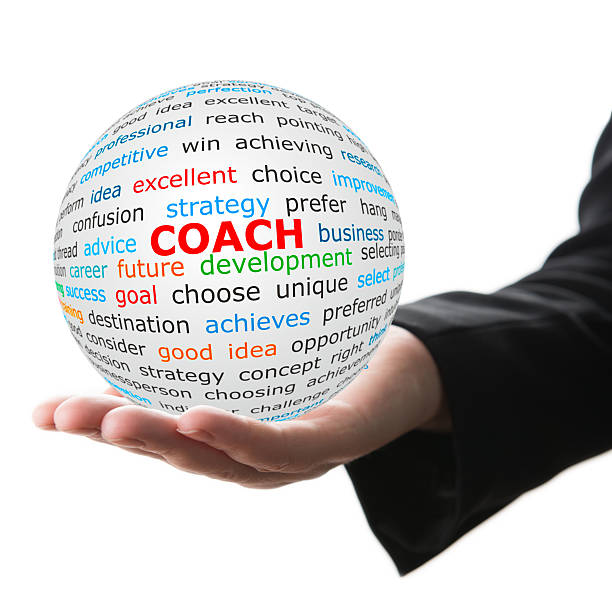 Hand take white ball with red inscription coach – Foto
