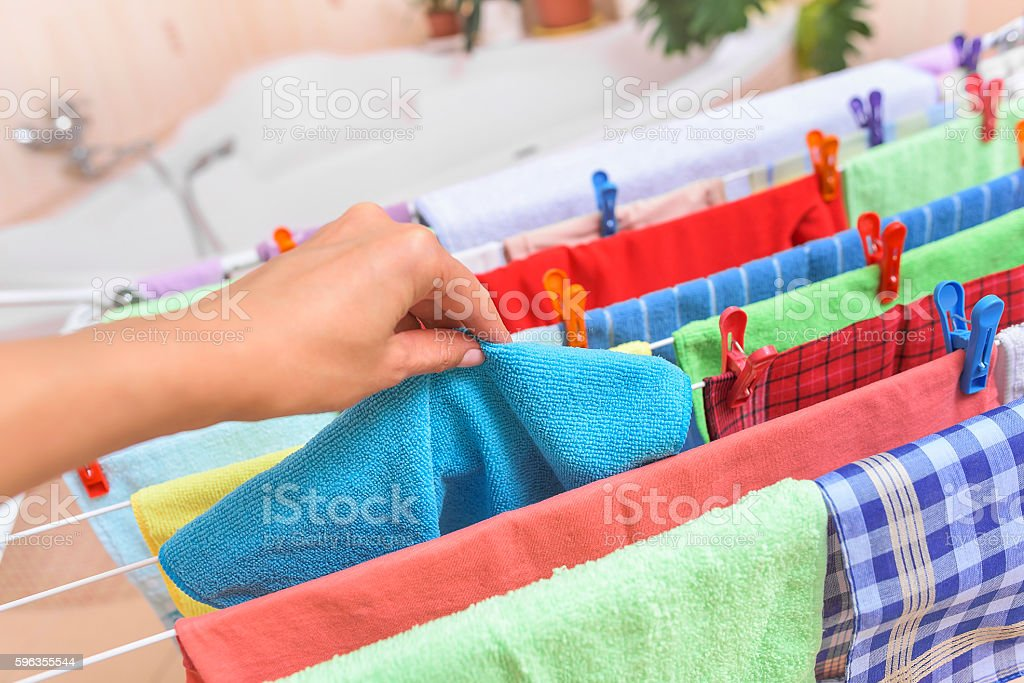 Hand takes away clothes from the dryer. royalty-free stock photo