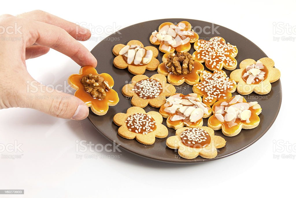 Hand taking a homemade butter cookie royalty-free stock photo