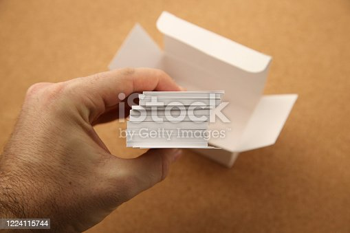 1131526784 istock photo A hand taking business cards out of white box. Network marketing concept image. 1224115744